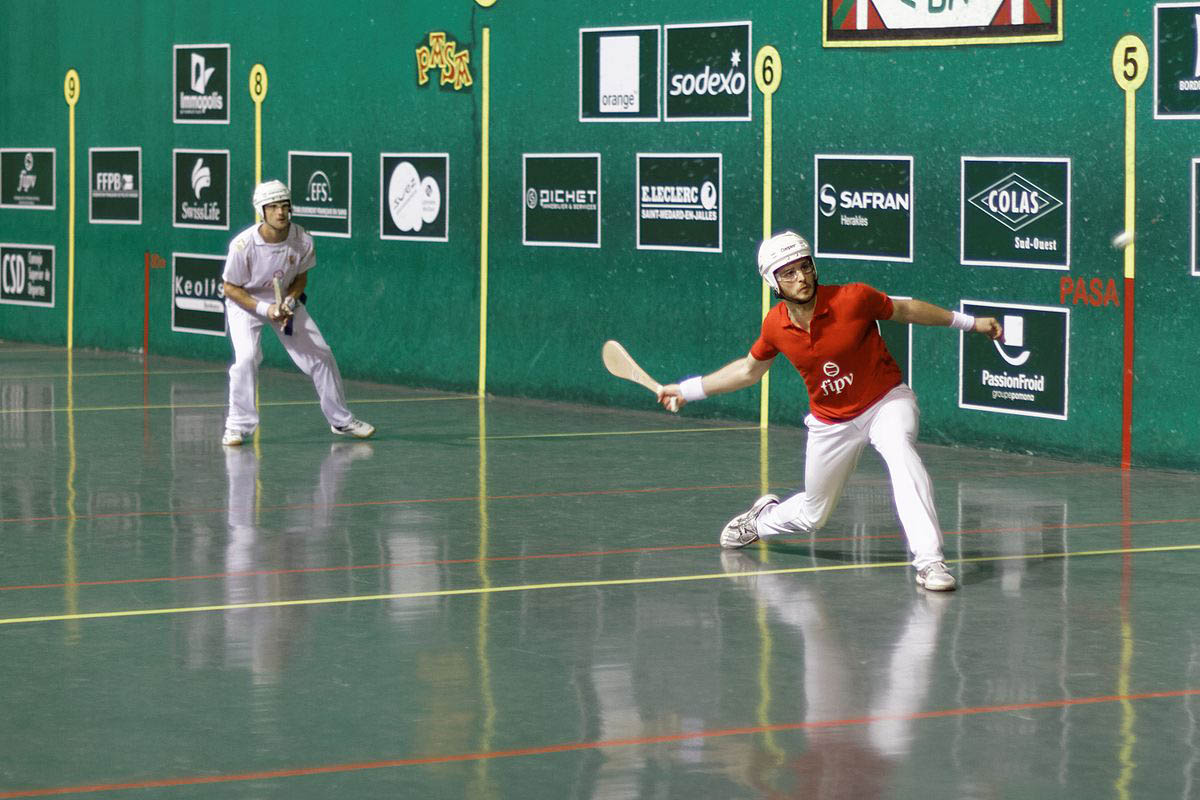 an overview of the jai alai ball in basque language Jai alai: a court game in from the american heritage® dictionary of the english language n a basque ball game in which the players propel the ball using a.
